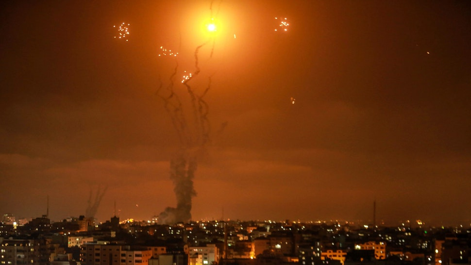10 May 2021, Palestinian Territories, Gaza City: Israel's Iron Dome aerial defence system intercepts rockets fired by the Palestinian Islamist movement Hamas from Gaza towards Israel. The Islamist Hamas movement that rules Gaza said Monday it launched several rockets at Israel in retaliation for Israeli action at a contested holy site in Jerusalem, meanwhile Israeli Prime Minister Benjamin Netanyahu threatened a harsh response.