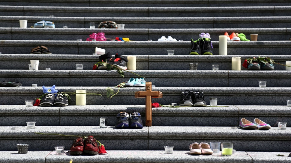 VANCOUVER, CANADA - MAY 29 : People gather outside Vancouver Art Gallery, where 215 pairs of kids shoes displayed on May 29, 2021 in Vancouver, British Columbia, Canada The remains of 215 children have been found buried at a Canadian residential school, an Indigenous band confirmed Thursday.