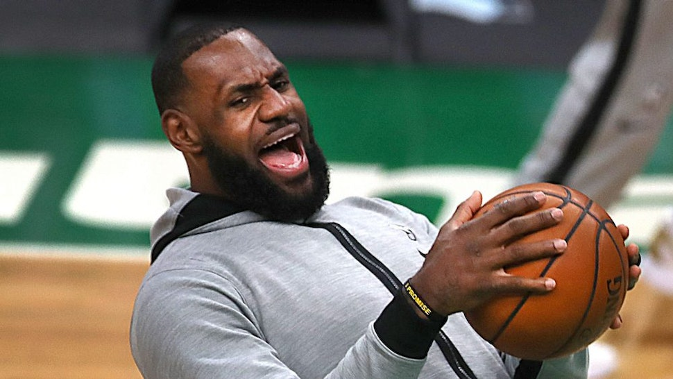 BOSTON - JANUARY 30: Los Angeles Lakers' LeBron James has a laugh in pregame warmups. The Boston Celtics host the Los Angeles Lakers in a regular season NBA game at TD Garden in Boston on Jan. 30, 2021.