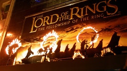 "Rings of fire burn near the movie poster for the film ""The Lord of the Rings: The Fellowship of the Ring."" The stars of the film attended the premiere in London."