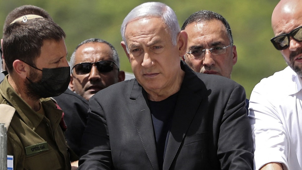 Israeli Prime Minister Benjamin Netanyahu (C) visits the site of an overnight stampede during an ultra-Orthodox religious gathering in the northern Israeli town of Meron, on April 30, 2021. - The massive stampede at the densely-packed site near the reputed tomb of Rabbi Shimon Bar Yochai, a second-century Talmudic sage, where mainly ultra-Orthodox Jews flock to mark the Lag BaOmer holiday, killed at least 44 people in northern Israel, blackening the country's largest COVID-era gathering.