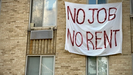 A banner against renters eviction reading no job, no rent is displayed on a controlled rent building in Washington, DC on August 9, 2020. - With double digit unemployment, disruption to businesses from social distancing rules, and persistent coronavirus spread, many Americans had been relying on relief measures approved earlier by Congress, but which mostly expired in July. One key Trump order promises to get $400 a week added to Americans' unemployment benefits, while two others offer some protection from evictions and relief for student loans.