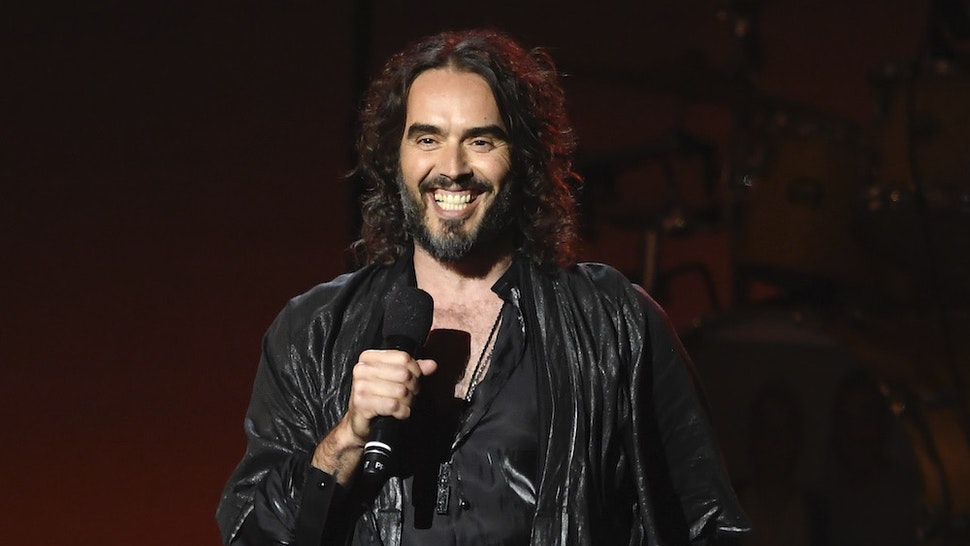 LOS ANGELES, CALIFORNIA - JANUARY 24: (EDITORS NOTE: Retransmission with alternate crop.) Russell Brand speaks onstage during MusiCares Person of the Year honoring Aerosmith at West Hall at Los Angeles Convention Center on January 24, 2020 in Los Angeles, California. (Photo by Kevork Djansezian/Getty Images for The Recording Academy)