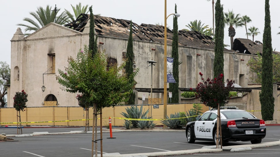 SAN GABRIEL, CA -JULY22: Fire investigators continued looking into what started the July 11 blaze that gutted the Mission San Gabriel Archangel church.