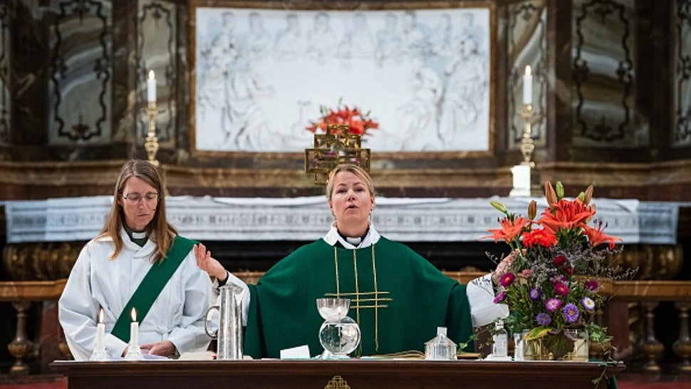 Priest Sandra Signarsdotter (R) and Deacon Ingrid El Qortobi gives the Sunday service at Gustaf Vasa Church in Odenplan, Stockholm on August 23, 2020. - In the Scandinavian country, often hailed as a champion of gender equality, the statistics are clear. As of July, 50.1 percent of priests are women and 49.9 percent are men.
