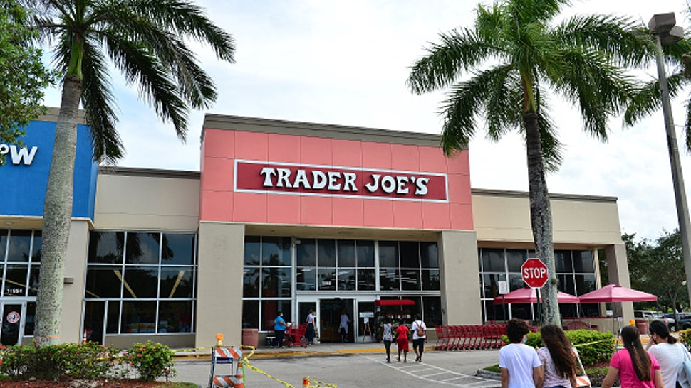 PEMBROKE PINES, FLORIDA - JULY 16: Customers wearing face masks enter a Trader Joe's store on July 16, 2020 in Pembroke Pines, Florida. Some major U.S. corporations are requiring masks to be worn in their stores upon entering to control the spread of COVID-19.