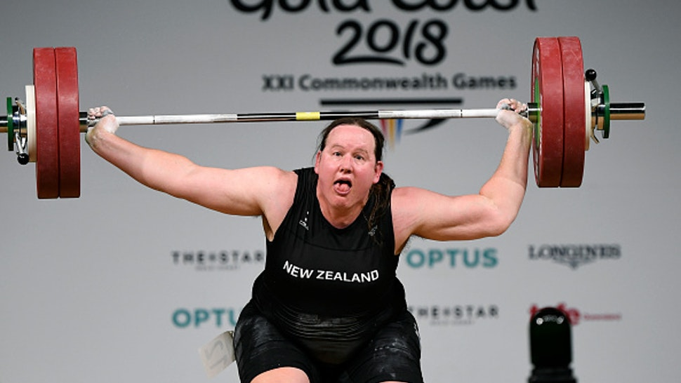 Laurel Hubbard of New Zealand reacts during the women's +90kg weightlifting final at the 2018 Gold Coast Commonwealth Games in Gold Coast on April 9, 2018, / AFP PHOTO / WILLIAM WEST