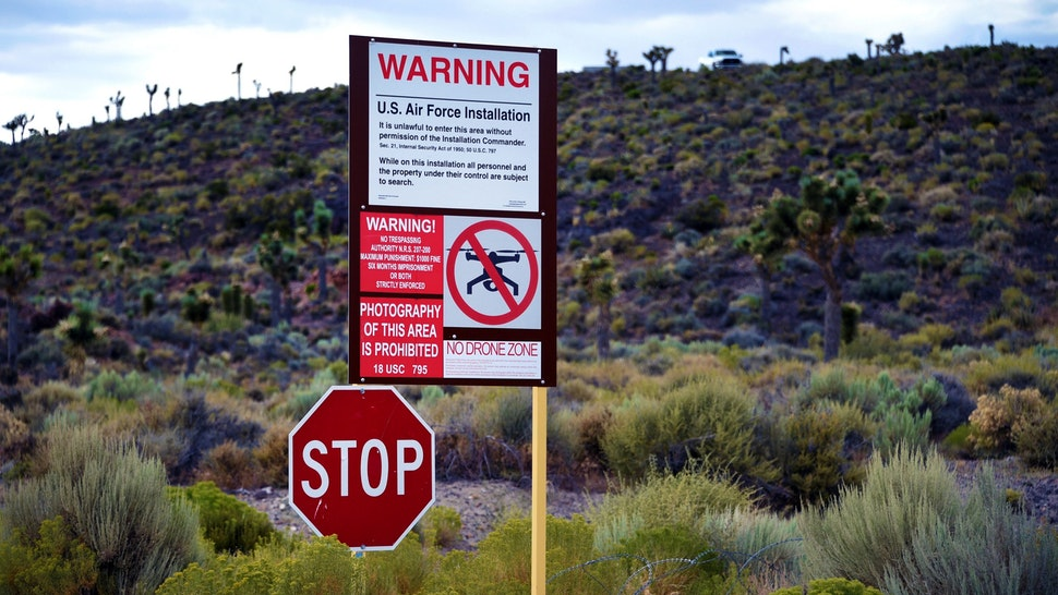 """RACHEL, NEVADA - JULY 22: A warning sign is posted at the perimeter of the top-secret military installation at the Nevada Test and Training Range known as Area 51 on July 22, 2019 near Rachel, Nevada. A Facebook event entitled, """"Storm Area 51, They Can't Stop All of Us,"""" which the author stated was meant as a joke, calls for people to storm the highly classified U.S. Air Force facility on September 20, 2019, to address a conspiracy theory that the U.S. government is conducting tests with space aliens."""