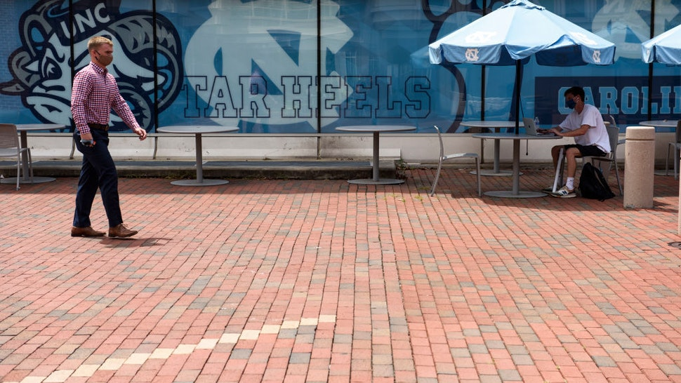 CHAPEL HILL, NC - AUGUST 18: Students walk through the campus of the University of North Carolina at Chapel Hill on August 18, 2020 in Chapel Hill, North Carolina. The school halted in-person classes and reverted back to online courses after a rise in the number of COVID-19 cases over the past week.