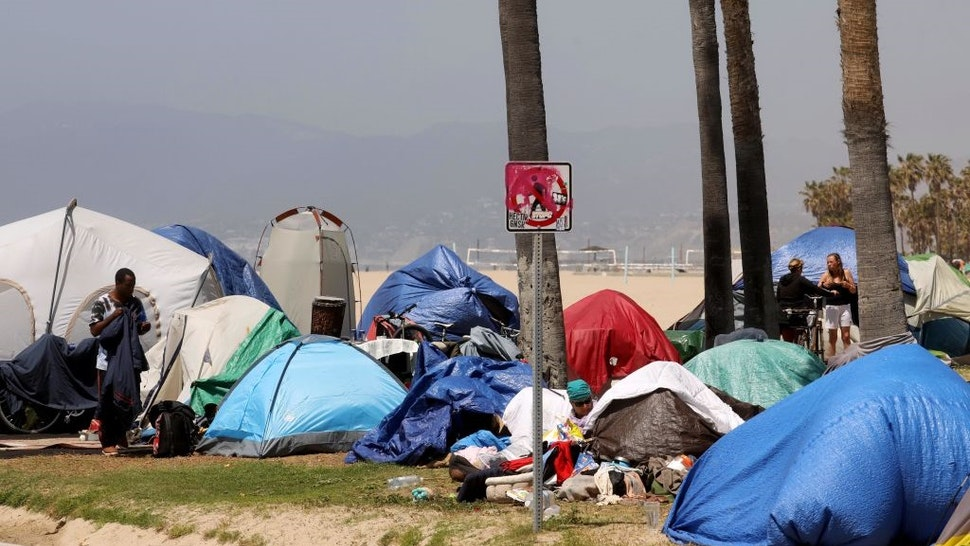 VENICE, CA - APRIL 16, 2021 - - A sea of homeless tents takes over an area between the bike path and Ocean Front Walk in Venice on April 16, 2021.