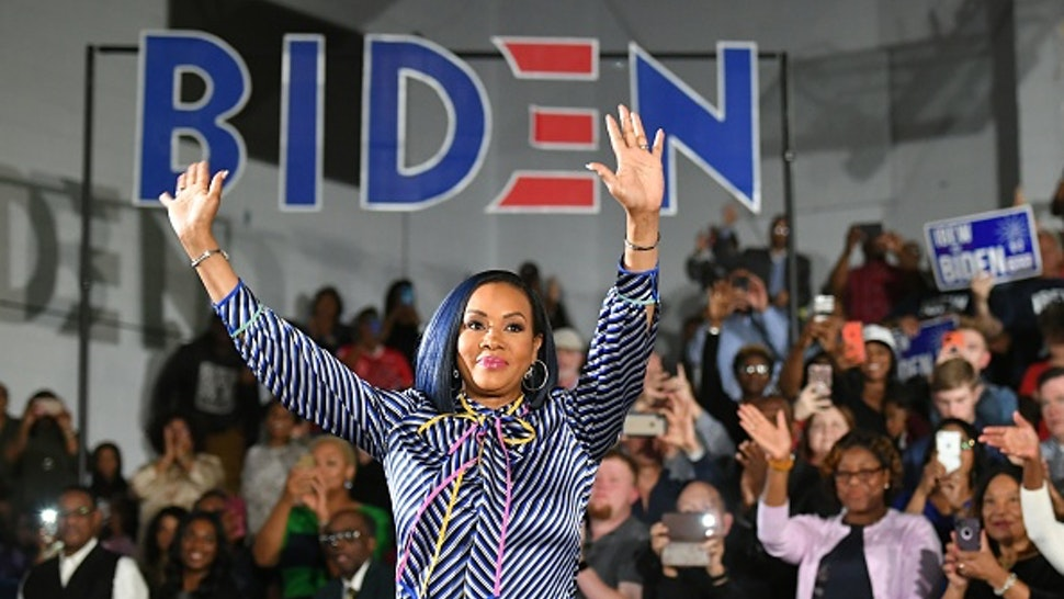 Actress Vivica Fox arrives on stange for a rally with Democratic presidential candidate Joe Biden during at Tougaloo College in Tougaloo, Mississippi on March 8, 2020.