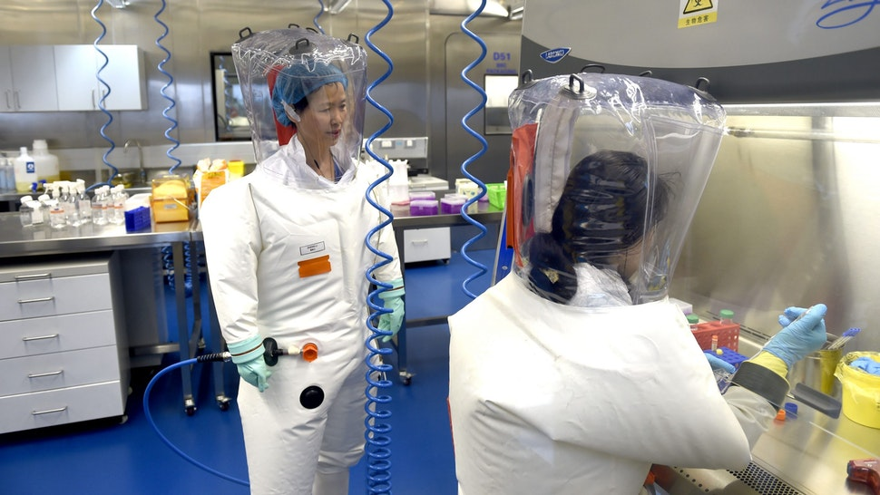 WUHAN, CHINA - FEBRUARY 23 2017: Virologist Shi Zheng-li, left, works with her colleague in the P4 lab of Wuhan Institute of Virology (WIV) in Wuhan in central China's Hubei province Thursday, Feb. 23, 2017.