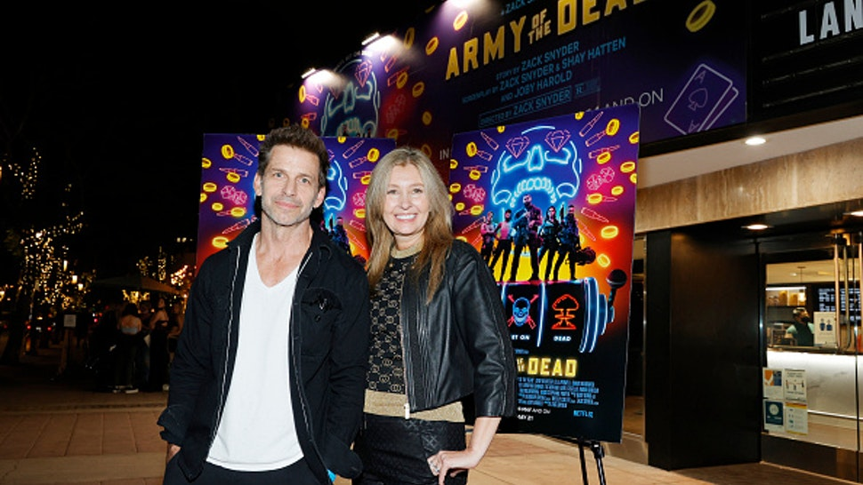 """LOS ANGELES, CALIFORNIA - MAY 14: Director Zack Snyder (L) and producer Deborah Snyder (R) attend the grand reopening of the newly renovated Landmark Theatre Westwood with the premiere screening of Zack Snyder's """"Army Of The Dead"""" at The Landmark Westwood on May 14, 2021 in Los Angeles, California."""