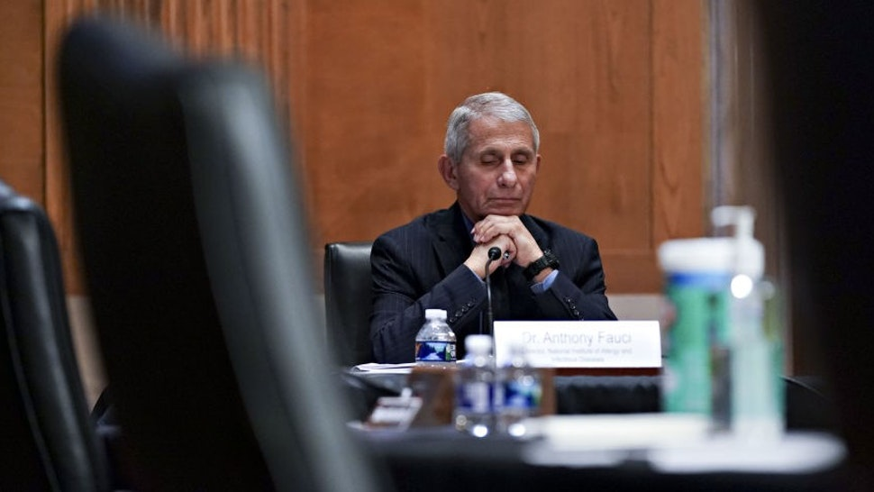 """Anthony Fauci, director of the National Institute of Allergy and Infectious Diseases, waits to begin a Senate Appropriations Subcommittee hearing in Washington, D.C., U.S., on Wednesday, May 26, 2021. The hearing is titled """"National Institutes of Health's FY22 Budget and the State of Medical Research."""" Photographer:"""