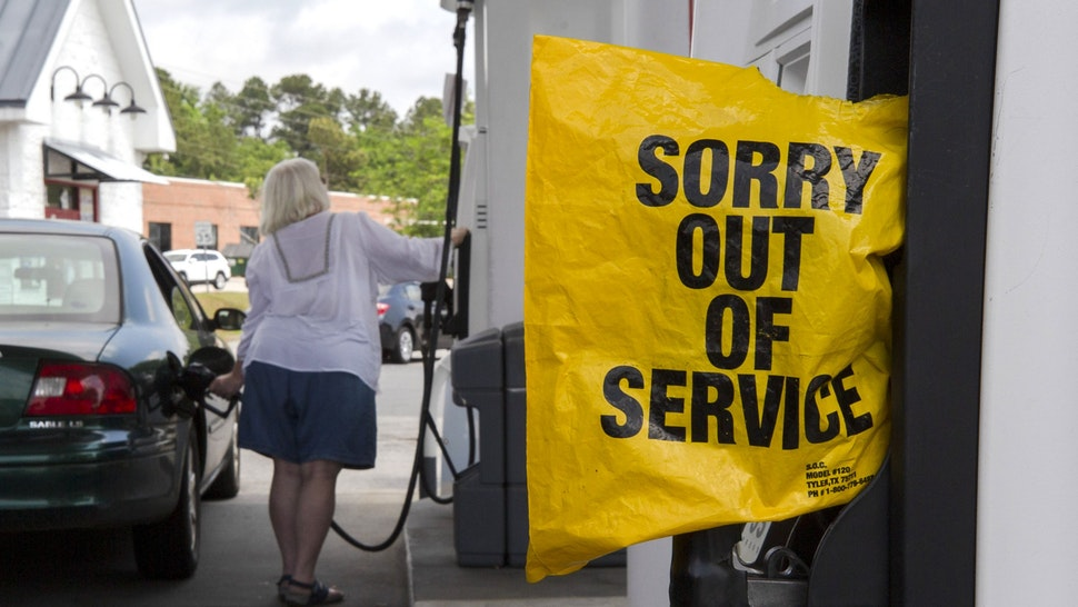 """A """"Sorry Out Of Service"""" bag covers a fuel pump at a Royal Dutch Shell gas station on Broad Street in Sumter, South Carolina, U.S., on Tuesday, May 11, 2021. Motorists across a broad swath of the U.S. East Coast and South are struggling to find gasoline and diesel as filling stations run dry amid the unprecedented pipeline disruption caused by a criminal hack."""