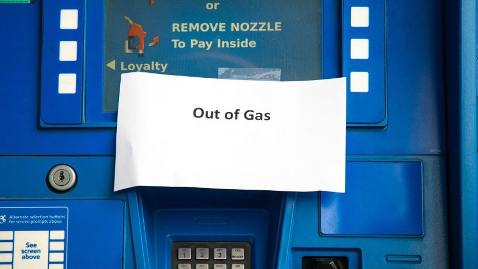 Notes are left on gas pumps to let motorists know the pumps are empty at an Exxon gas station in Charlotte, North Carolina on May 12, 2021. - Fears the shutdown of the Colonial Pipeline because of a cyberattack would cause a gasoline shortage led to some panic buying and prompted US regulators on May 11, 2021 to temporarily suspend clean fuel requirements in three eastern states and the nation's capital. (Photo by Logan Cyrus / AFP) (Photo by