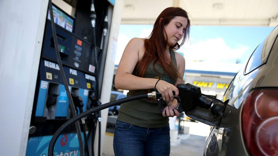 PEMBROKE PINES, FL - APRIL 21: Gabrielle Smith pumps gas at the Victory gas station on April 21, 2014 in Pembroke Pines, Florida. According to the Lundberg Survey the average price for a gallon of regular gas is now $3.69- the highest price since March of last year.