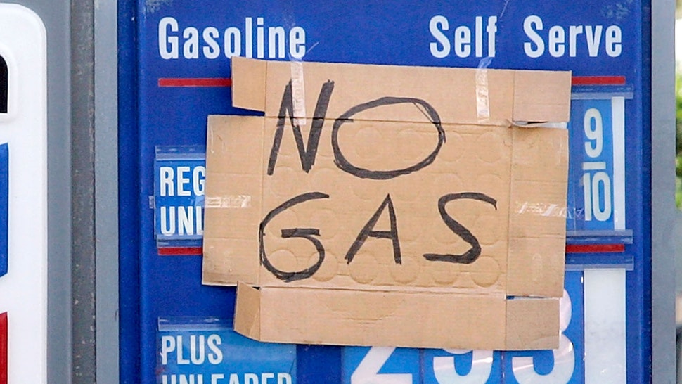 """FT. LAUDERDALE - OCTOBER 27: A sign that reads,"""" No Gas"""" hangs on a Chevron gas station in South Florida that had no power to pump gas October 27, 2005 in Ft. Lauderdale, Florida. Hurricane Wilma tore through the area leaving millions without power while doing billions of dollars worth of damage."""