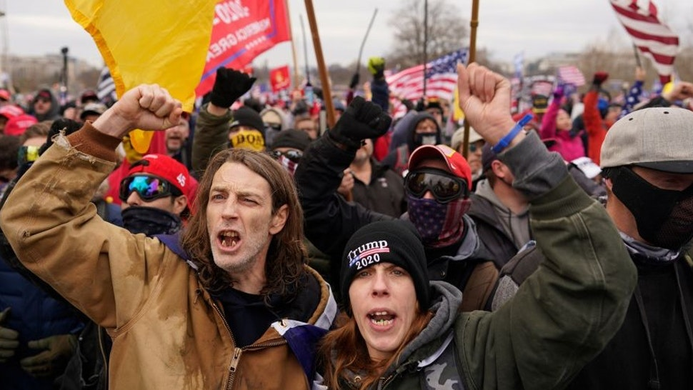 WASHINGTON, DC - JANUARY 06: Protesters gather storm the Capitol and halt a joint session of the 117th Congress on Wednesday, Jan. 6, 2021 in Washington, DC. (