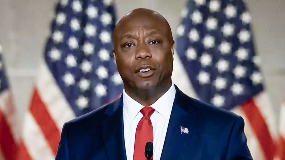 Senator Tim Scott, a Republican from South Carolina, speaks during the Republican National Convention seen on a laptop computer in Tiskilwa, Illinois, U.S., on Monday, Aug. 24, 2020. President Trump plans to appear nightly during the four-day convention, which after today will be staged mostly from Washington because of the coronavirus pandemic. Photographer: