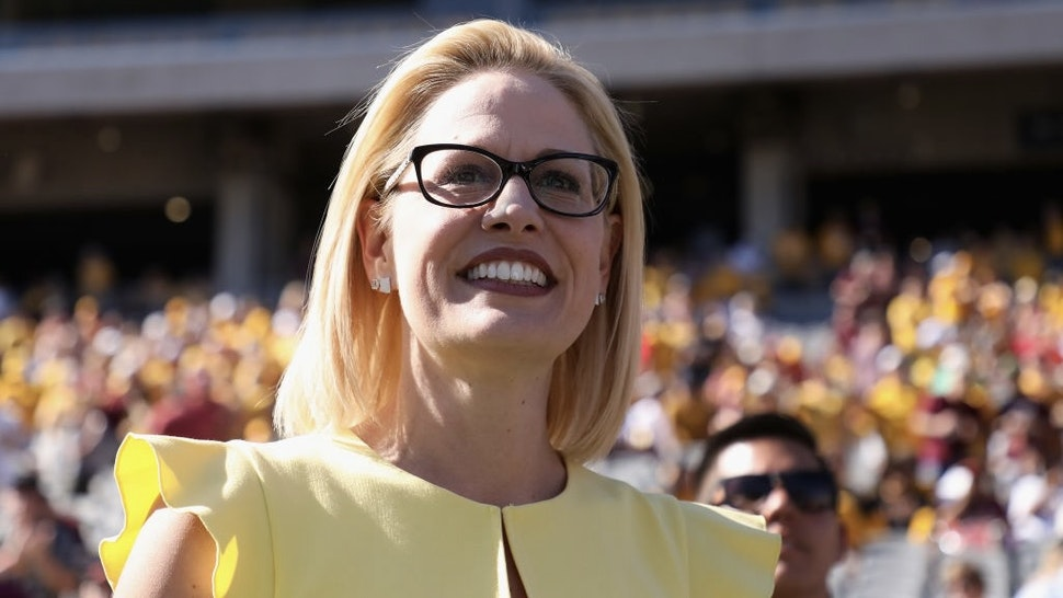Arizona Senate Candidates Attend Arizona State Football Game TEMPE, AZ - NOVEMBER 03: Democrat U.S. Senate candidate Kyrsten Sinema participates in the pregame coin toss before the game between the Utah Utes and the Arizona State Sun Devils at Sun Devil Stadium on November 3, 2018 in Tempe, Arizona. Sinema is running against two-term congresswoman Martha McSally. (Photo by Christian Petersen/Getty Images) Christian Petersen / Staff via Getty Images