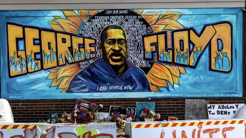 US-JUSTICE-RACE-FLOYD The George Floyd Memorial is barricaded on June 3, 2021, as the city of Minneapolis orders the square cleared for traffic. - Minneapolis spokesperson Sarah McKenzie said crews, along with a community group, are taking great care to preserve artwork and artifacts. (Photo by Kerem YUCEL / AFP) (Photo by KEREM YUCEL/AFP via Getty Images) KEREM YUCEL / Contributor via Getty Images