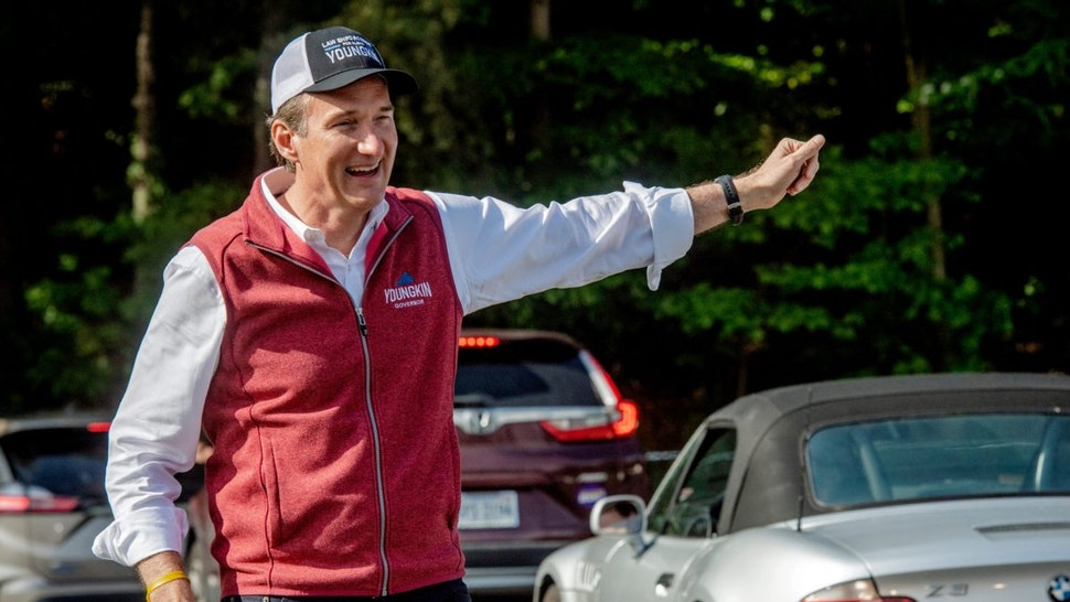 Gubernatorial candidate Glenn Youngkin works the line of cars as the Virginia GOP holds a drive through primary to select candidates for the 2021 general election, in Annandale, VA.