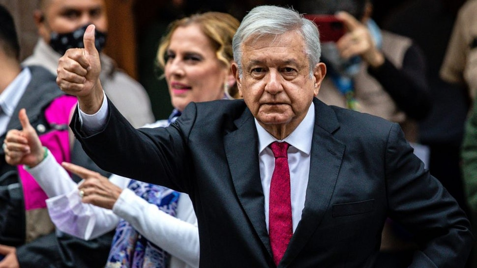 MEXICO CITY, MEXICO - JUNE 06: President of Mexico Andres Manuel Lopez Obrador gives a thumb up after voting at the polling place on June 06, 2021 in Mexico City, Mexico. A record number of 93.5 million citizens are able to vote today in the largest election in the country's history. 500 deputies, governors in 15 states and 20,000 local authorities will be elected. During the campaign, 35 candidates were reported murdered.
