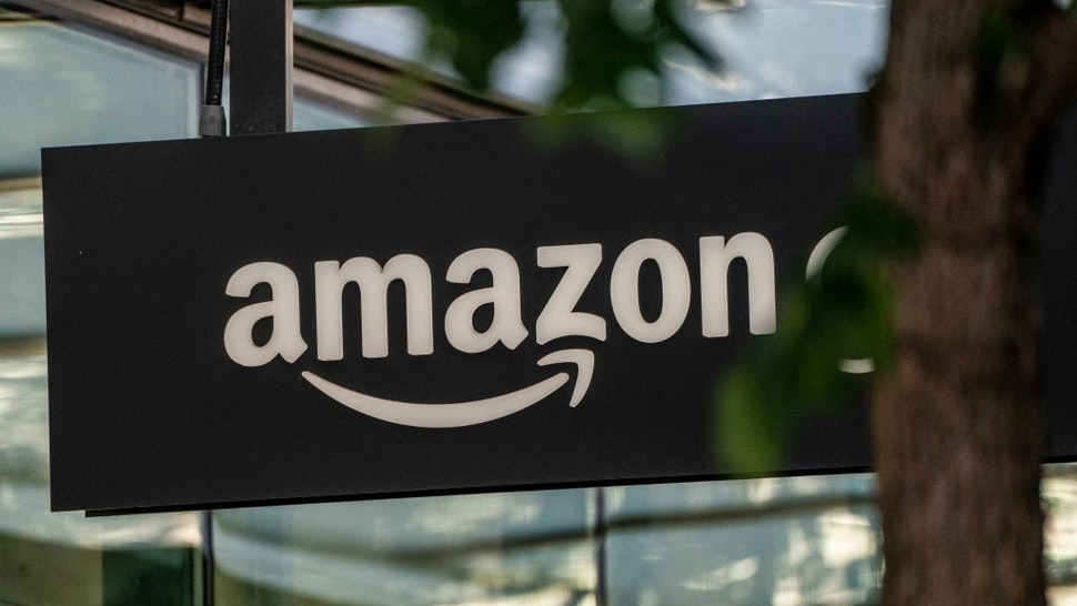 SEATTLE, WA - MAY 20: A sign is seen outside of an Amazon Go store at the Amazon.com Inc. headquarters on May 20, 2021 in Seattle, Washington. Five women employees sued Amazon this week, alleging discrimination and retaliation.