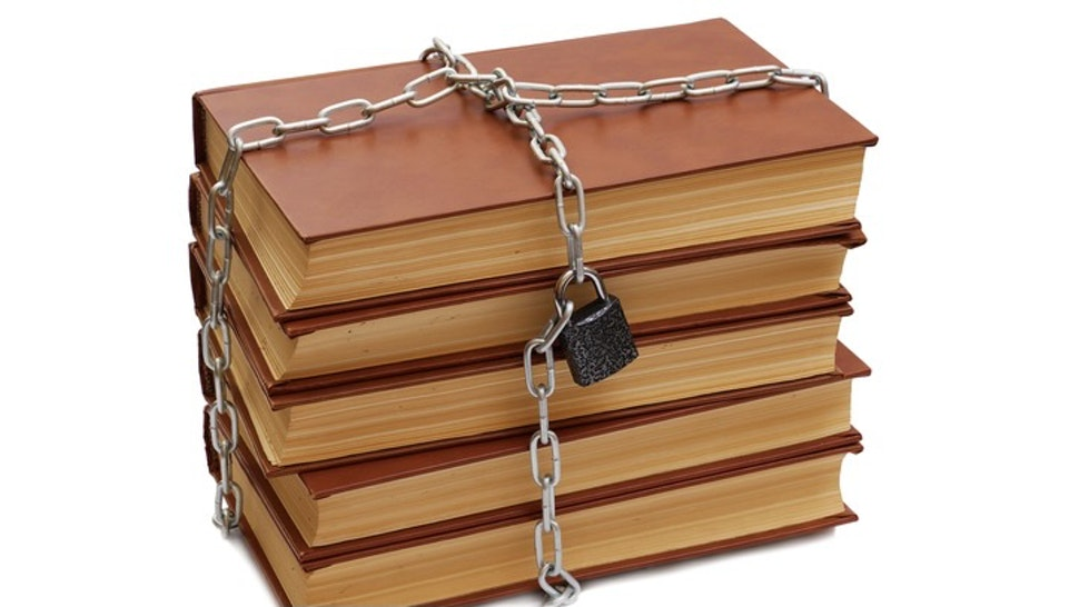 stack of books wrapped by chain with padlock isolated on white background - stock photo stack of books wrapped by chain with padlock isolated on white background asadykov via Getty Images
