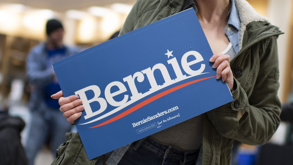 Supporters of Democratic White House hopeful Bernie Sanders hold posters with his name at the venue where the Senator from Vermont will hold a campaign rally later on February 29, 2020 in Virginia Beach, Virginia. - Voters headed to the polls in South Carolina on Saturday with Joe Biden looking for a first primary win to stall Bernie Sanders' drive to the Democratic presidential nomination.
