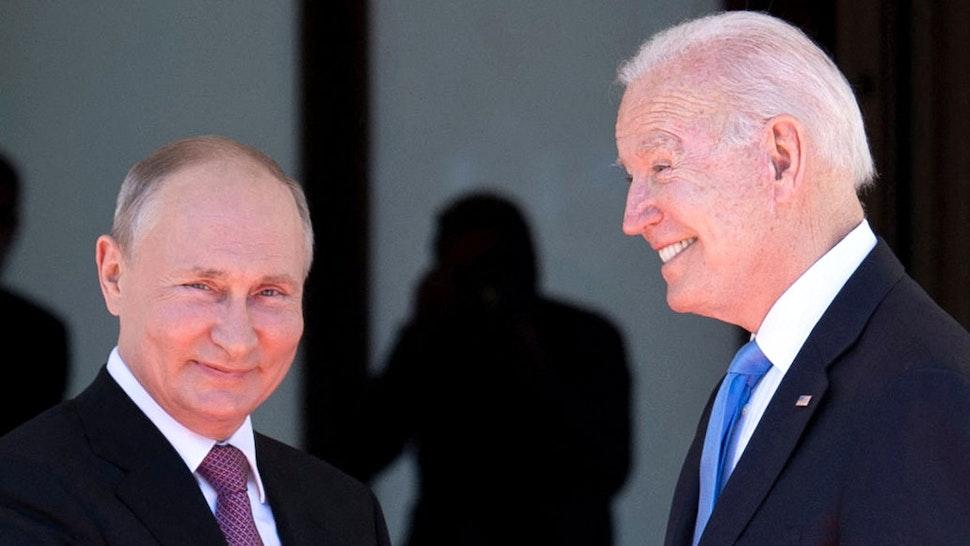 TOPSHOT - Russian President Vladimir Putin (L) shakes hands with US President Joe Biden prior to the US-Russia summit at the Villa La Grange, in Geneva on June 16, 2021.