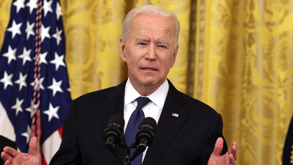 WASHINGTON, DC - MAY 20: U.S. President Joe Biden gestures during his remarks, as Vice President Kamala Harris looks on, before a signing ceremony for the COVID-19 Hate Crimes Act in the East Room of the White House on May 20, 2021 in Washington, DC. The legislation, drafted in response to the increased violence against the Asian American and Pacific Islander (AAPI) community during the Coronavirus pandemic, will create a new position in the Department of Justice to focus on the rise in hate crimes and provide resources to federal, state, and local jurisdictions to better report cases.