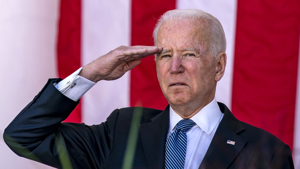 U.S. President Joe Biden saalutes during a Memorial Day ceremony at Arlington National Cemetery in Arlington, Virginia, U.S., on Monday, May 31, 2021. Biden's $6 trillion budget request proposes record spending to reduce historical disparities in underserved communities, following his campaign pledge to promote racial equity as an inseparable part of rebuilding the economy.