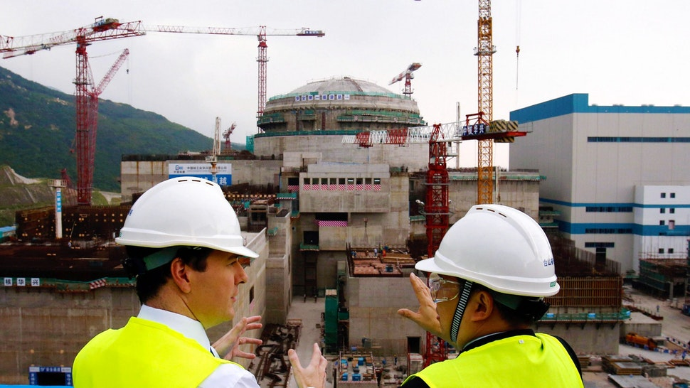 TAISHAN, CHINA - OCTOBER 17: British Chancellor of the Exchequer George Osborne talks with Guo Liming of Taishan Nuclear Power Joint Venture Co Ltd (R) as he tours a nuclear reactor under construction at Taishan power plant on October 17, 2013 in Taishan, Guangdong province, China. Chancellor George Osborne has announced on the last day of his trade visit that future generations of British nuclear power plants will be funded, developed and managed in joint UK and Chinese partnership agreements, with China expected to hold majority stakes.
