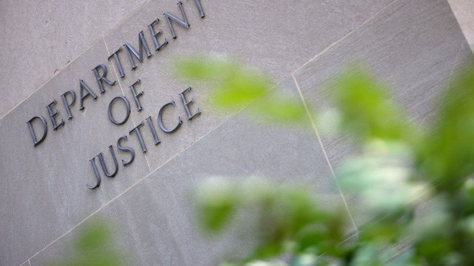 WASHINGTON, DC - JUNE 14: A sign at the U.S. Department of Justice is seen on June 14, 2021 in Washington, DC. U.S. Attorney General is expected to meet with media executives, including members of CNN, The New York Times and The Washington Post, after Trump's Justice Department attempted to obtain email and phone records from journalists.