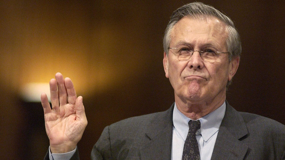 US Secretary of Defense Donald Rumsfeld is sworn in before the Senate Armed Services Committee in Washington, DC before testifying on abuses at a military prison in Iraq on May 7, 2004. Donald Rumsfeld, the defense secretary who became the face of U.S. foreign policy under President George W. Bush while the administration's troop deployments toppled hostile regimes in Afghanistan and Iraq, has died on June 30, 2021.. He was 88. Photographer: Jay Mallin / Bloomberg