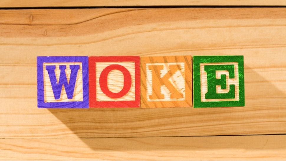 Spectacular wooden cubes with the word WOKE on a wooden surface. - stock photo Spectacular wooden cubes with the word WOKE on a wooden surface. Alexander Sanchez via Getty Images