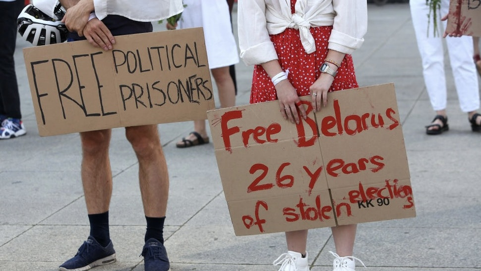 Protesters Decry Belarus Official Election Result BERLIN, GERMANY - AUGUST 15: Protestors attend a demonstration against the results of Belarus' presidential election the previous weekend, in which President Alexander Lukashenko, the only ruler the country has had, claimed victory and another term in his 26-year rule of the country, on August 15, 2020 in Berlin, Germany. Preliminary results gave Lukashenko 80% of the vote, which opposition candidates allege is a rigged count. The main opposition to Lukashenko, Sviatlana Tsikhanouskaya, has fled to Lithuania, and the European Union has condemned both the election outcome as well as the government's violence against protesters participating in the demonstrations against Lukashenko's victory that followed. (Photo by Adam Berry/Getty Images) Adam Berry / Stringer via Getty Images
