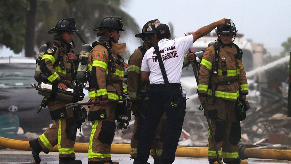 SURFSIDE, FLORIDA - JUNE 24: Miami-Dade Fire Rescue personnel continue search and rescue operations at the 12-story Champlain Towers South condo building that partially collapsed on June 24, 2021 in Surfside, Florida. It is unknown at this time how many people were injured as search-and-rescue effort continues with rescue crews from across Miami-Dade and Broward counties. According to reports, almost 100 people are still unaccounted for.