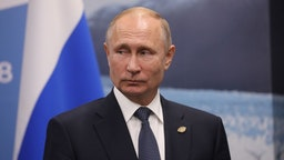 Russia's President Vladimir Putin gestures during a meeting with France's President Emmanuel Macron (out of frame) in the sidelines of the G20 Leaders' Summit in Buenos Aires, on November 30, 2018. - Global leaders gather in the Argentine capital for a two-day G20 summit beginning on Friday likely to be dominated by simmering international tensions over trade. (Photo by Ludovic MARIN / AFP) (Photo credit should read LUDOVIC MARIN/AFP via Getty Images)