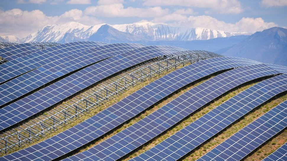 A general view shows the photovoltaic solar pannels at the power plant in La Colle des Mees, Alpes de Haute Provence, southeastern France, on April 17, 2019. - The 112,000 solar panels cover an area of 200 hectares with a total capacity of 100MW. (Photo by GERARD JULIEN / AFP) (Photo credit should read GERARD JULIEN/AFP via Getty Images)