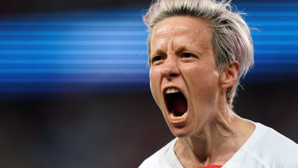 TOPSHOT - United States' forward Megan Rapinoe celebrates after scoring a goal during the France 2019 Women's World Cup quarter-final football match between France and USA, on June 28, 2019, at the Parc des Princes stadium in Paris.