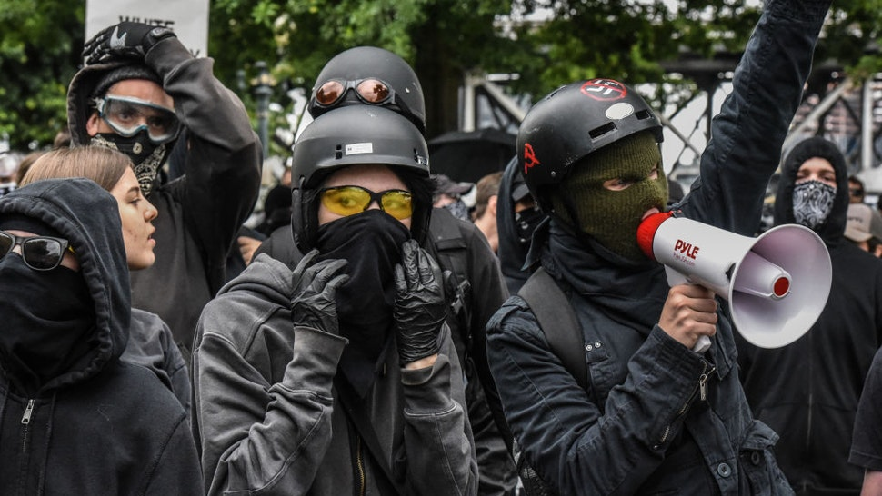 PORTLAND, OR - AUGUST 17: Counter-protesters wear black clothes during an Antifa gathering during an alt-right rally on August 17, 2019 in Portland, Oregon. Anti-fascism demonstrators gathered to counter-protest a rally held by far-right, extremist groups. (Photo by Stephanie Keith/Getty Images)