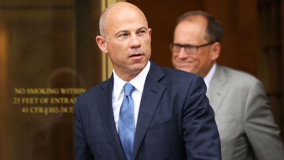 Celebrity attorney Michael Avenatti walks out of a New York court house after a hearing in a case where he is accused of stealing $300,000 from a former client, adult-film actress Stormy Daniels on July 23, 2019 in New York City.