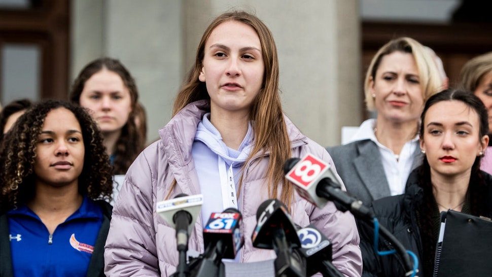 Canton High School senior Chelsea Mitchel speaks during a press conference with Alanna Smith, Danbury High School sophomore, to her left and Selina Soule, Glastonbury High School senior, to her right at the Connecticut State Capitol Wednesday, Feb. 12, 2020, in downtown Hartford, Conn. The families of high school athletes Selina Soule, Alanna Smith and Chelsea Mitchell have filed a federal lawsuit against the Connecticut Association of Schools and multiple school districts alleging discrimination. The athletes say they lost out on top finishes and possible scholarship opportunities because a statewide policy allows transgender athletes to compete against cisgender girls. (Kassi Jackson/Hartford Courant/Tribune News Service via Getty Images)