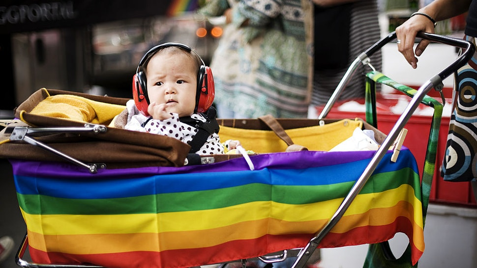 """A child with ear-protection gear looks on during the HBTQ festival """"Stockholm Pride"""" parade on August 6, 2011 in central Stockholm."""