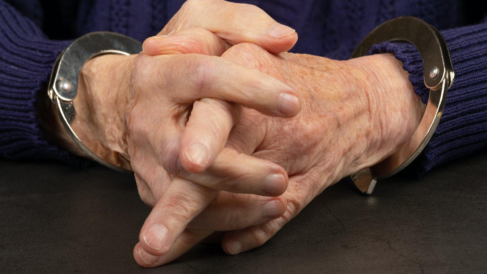 andcuffed elderly woman - stock photo