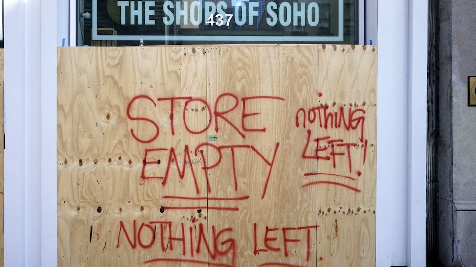 The Shoes of Soho store is seen boarded up on June 8, 2020 after rampant open looting and vandalism in New York, following the Minneapolis police killing of George Floyd.