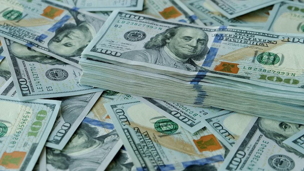 Stacking of US Dollar bank notes.